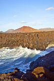 Steep coast at Los Hervideros in Lanzarote with huge waves Royalty Free Stock Photos