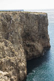 Steep coast in most western point, Sagres, Portugal Royalty Free Stock Image