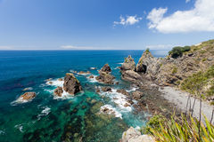 Steep Coastal Cliff Landscape with green ocean Stock Photos