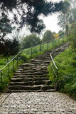 Steep cobbled pathway up hillside Royalty Free Stock Images