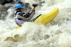 Steep Creek Championship - Vail Colorado. Conor Flynn paddles through rough whitewater during the Steep Creek Championship in Vail, Colorado on June 3, 2010. The Royalty Free Stock Photos