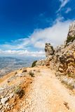 Steep dangerous mountain road with a big gravel in the mountains of Sardinia, Italy Stock Photos