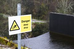 Steep deep drop danger warning sign waterfall stock images