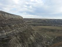 Steep Drop. An eroded, sheer edge of a ravine provides an example of typical Albertan geology Royalty Free Stock Image