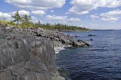 Steep granite shores of Lake Ladoga. Karelia, Russia. Royalty Free Stock Images