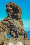Steep high lava rock cliffs. Blue sea horizon, natural sky background royalty free stock photos