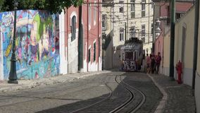 Steep hill with funicular tram moving down it stock video footage