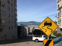 Steep hill in San Francisco. Steep hill with Alactraz at the background in San Francisco, United States royalty free stock images
