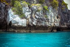 Steep limestone island  of the Andaman Sea Royalty Free Stock Images
