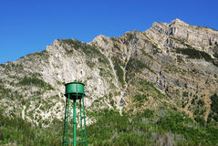 Steep mountain cliff and water tower royalty free stock photo