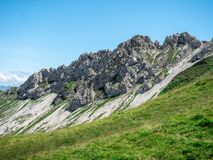 Steep mountain cliffs during summer sunny day in the swiss alps. Sorenberg royalty free stock image