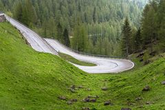 Steep Mountain Road in the Alps in Spring stock photo