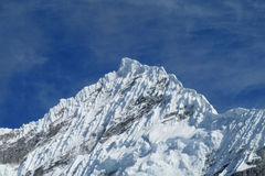Steep mountainside with snow and ice royalty free stock photo