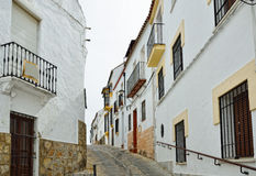Steep narrow street in the ancient Ronda Royalty Free Stock Photos