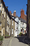 Steep narrow street with houses on either side Stock Images