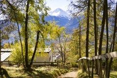 Steep Path Through Austrian Mountain Village. Steep Mountain Path with Houses and Fence Through Quaint Village Looking Down Towards Valley in Alpine Region Royalty Free Stock Image