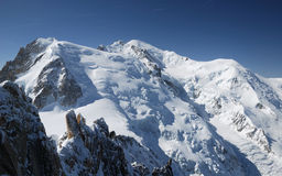 Steep peaks and snow slopes Royalty Free Stock Photos