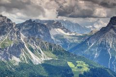 Steep ridges of Sexten Dolomites over forested valleys in Italy stock photos