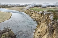 Steep riverbank Stock Images