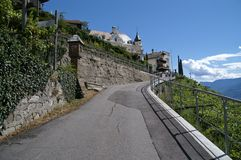Steep road in Alpine landscape Royalty Free Stock Photos