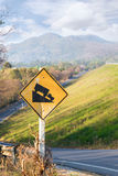 Steep road traffic sign in yellow and black Royalty Free Stock Photography