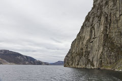 Steep rock at coast in norway Stock Images