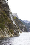 Steep rock at coast in norway Stock Photography