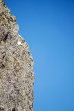 Steep rock and sky Stock Photos