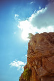 Steep rocks with place against sun sky backlight Royalty Free Stock Image