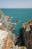 Steep and rocky cliff at the Taejongdae Resort Park in Busan Royalty Free Stock Photo