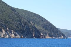 Steep, rocky coastline with forest on the island of Elba, Italy stock photo