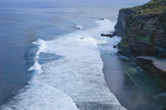 Steep rugged cliffs and ocean waves Bali Indonesia. Steep Cliffs and ocean waves Bali Indonesia Stock Images