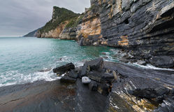 Steep shoreline cliffs. Steep cliffs along the rocky shoreline sometimes called Byrons Grotto, near Porto Venere, Italy Stock Photography