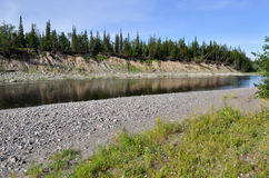 Steep shores of the taiga rivers. Stock Image