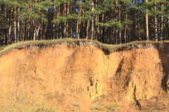 Steep slope. Abrupt rock (breakage on a hill) after long rains there was a soil erosion Stock Image