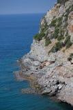 Steep slopes descending to the sea Stock Photos