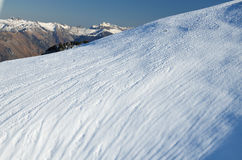 Steep snow downhill with traces Stock Photography