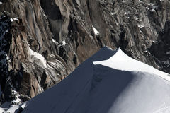 Steep snow dunes on top of mountain in Mont Blanc massif in France Royalty Free Stock Images