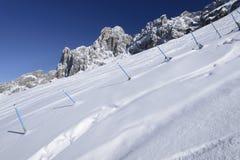 Snow on steep slope and Rosengarten, Costalunga pass Stock Photo