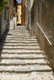 Steep stair in narrow alley at Varenna, Italy Stock Photos