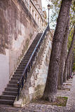 Steep stairs at the Paris embankment and trees Royalty Free Stock Photography