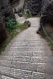Steep stairs in Shilin stone forest, world-famous natural karst area, China Royalty Free Stock Image