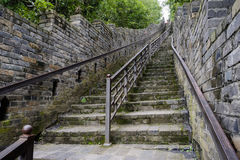 Steep stairway of ancient defensive wall on mountainside in summ Stock Image
