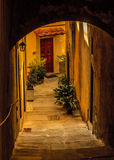 Steep, stepped alley in an Italian hill town. An inviting front door in Cortona, Tuscany, Italy Royalty Free Stock Photo