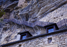 Steep steps hug the cliffs above the village of La. Steep wooden steps hug the cliffs above the village of La Roque-Gageac on the River Dordogne and head up Stock Image