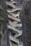 Steep steps rising up Guatape Rock, the Piedra el Penol, Colombi Royalty Free Stock Photos