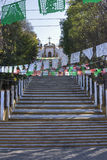 Steep steps to church on hill Stock Image