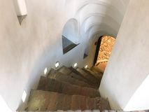 Steep stone spiral stairs going down from the steps royalty free stock photography