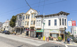 Steep street with old buildings typical for San Francisco. Royalty Free Stock Image