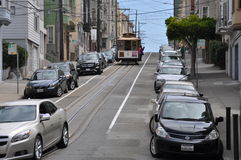 Steep street with trolley in Russian Hill, San Francisco. August 2014 - View of a very steep street with cars and trolley in Russian Hill, San Francisco ( Royalty Free Stock Images